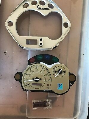 vespa lx150  Speedometer Clock Face And Surround .2013