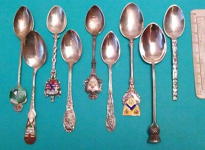 The  Vintage Canada 23 Different Colored  Sterling Silver Souvenir Spoons .