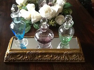 vintage perfume bottle on a stunning brass like stand with mirror. 3 bottles.