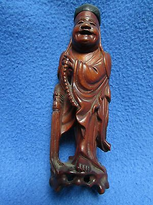 old Chinese carved wood figure of a man holding beads and a brush