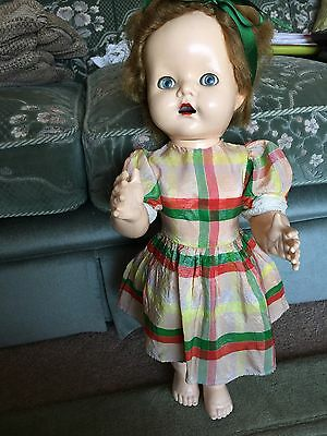 1950's PEDIGREE WALKING DOLL WITH CLOTHES.
