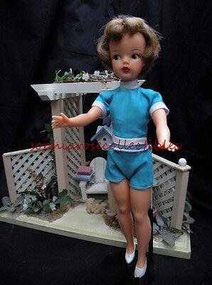 all original vintage blonde TAMMY doll by IDEAL TOY CORP. in turquoise jumpsuit