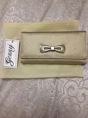 New gold purse wallet with bow.