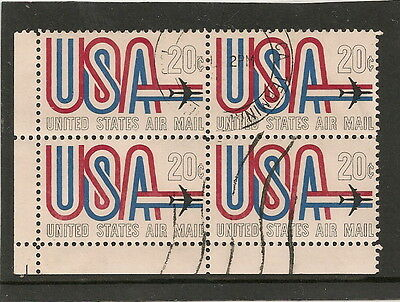 Used corner block of  four 20C US air mail stamps. SG1350. 1963.