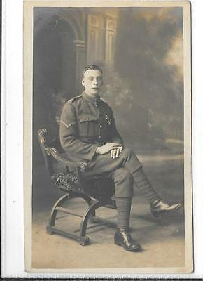 WW1 Photographic Postcard British Soldier in Uniform Wearing a Medal