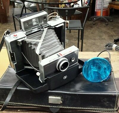 Vintage Polaroid Automatic 100 Land Camera.  With original case and flash.
