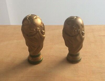 2 Mini Hard Plastic World Cup Trophies (4Cms Tall) 1 Bronze 1 Gold Coloured