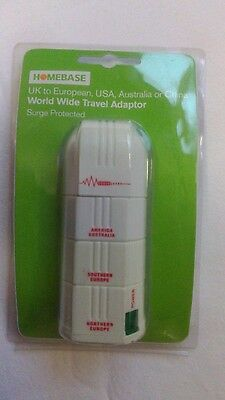 Homebase Brand new in pack Worldwide Travel Adaptor with surge protector