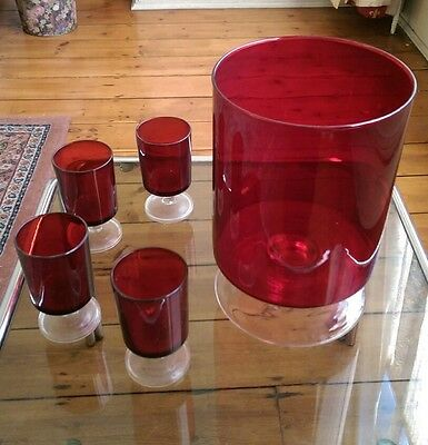 red glass vase and wine glass set