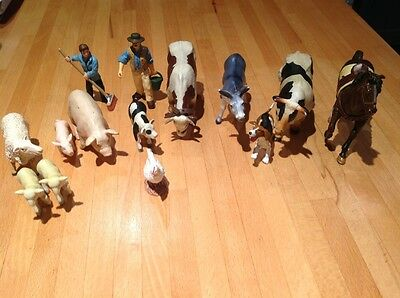 A collection of fourteen papo farmyard animals and keepers
