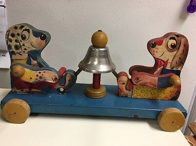The Gong Bell Mfg Co Dog Push Pull Toy