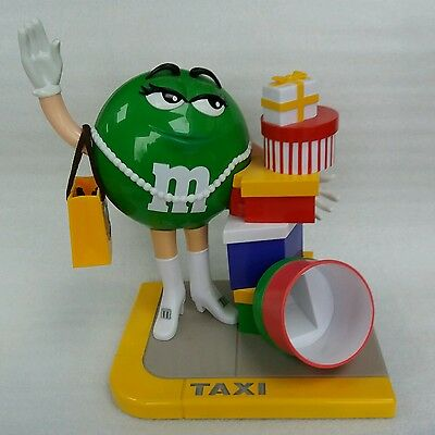M & M's  SHOPAHOLIC SWEET CANDY DISPENSER WITH GREEN  FIGURE