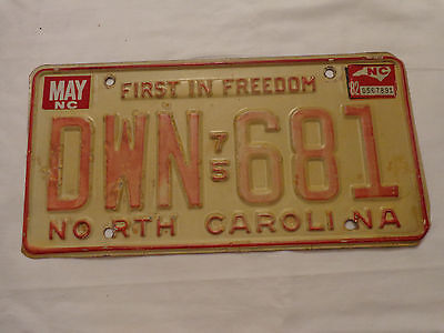 North Carolina NC Metal 1975  License Plate 75 Car Tag DWN 681 Red on White