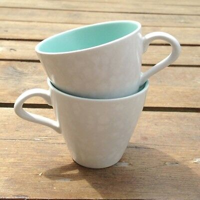 Two Poole Pottery Twintone Contour Coffee Cups in Seagull and Ice Green
