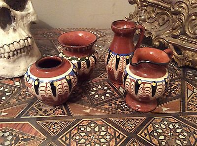 4 miniature pottery jugs and vases hand painted