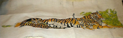 Unfinished needlework  of tiger and cub/