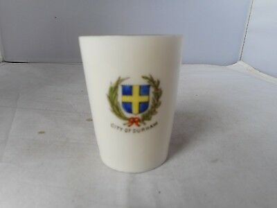 CRESTED CHINA BEAKER(6.25cms high)WITH CITY OF DURHAM COAT OF ARMS ON SIDE