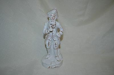 White and gold Porcelain figurine - 17th century man