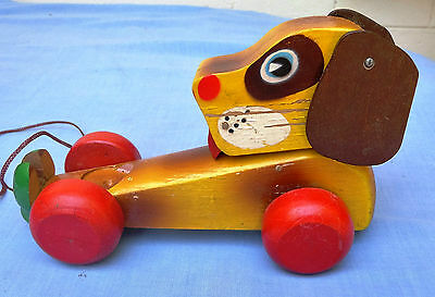 Vintage 1950s wooden pull along toy dog