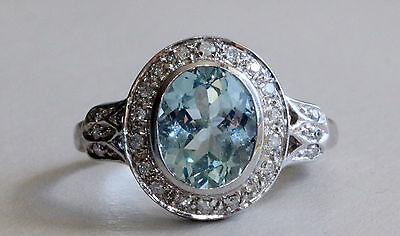 9k white gold aquamarine and diamond cluster ring
