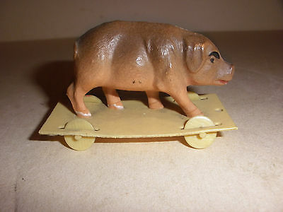 Rare antique Vintage Viscoloid Toy Celluloid pig on platform with four wheels