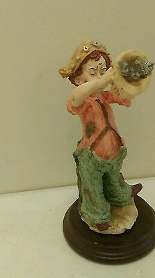Vintage Mann Collectable Boy in Clown Costume With Trumpet and bird