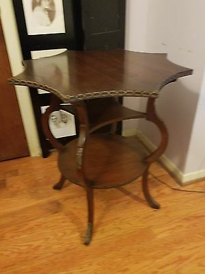 Rare Mahogany star top side table with double shelf