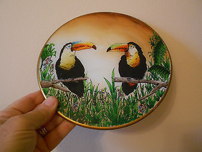 """toucan round colorful gloss plaque- vg+  8"""" across"""