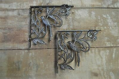 A pair of antique Victorian exotic bird brackets cast iron shelf bracket AL23