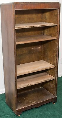 Antique Book Case with wooden casters and rounded waterfall top