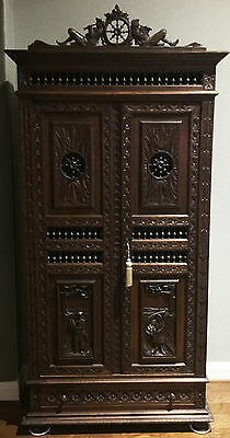 Antique Britania French two-door oak carved armoire
