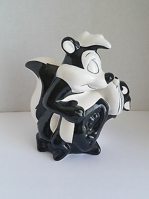 Warner Brothers 1997 Pepe Le Pew Skunk and Penelope Cat Coin Bank