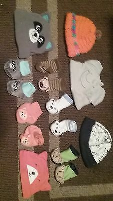 lot of baby hats and booties