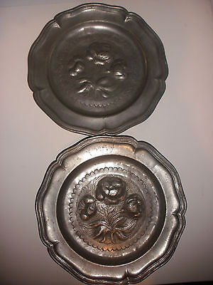 Pair of antique early pewter plates decorated with flowers hallmarks