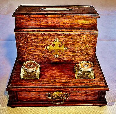 A Victorian Oak and Brass Bound Desk Tidy with Glass Inkwells and Drawer