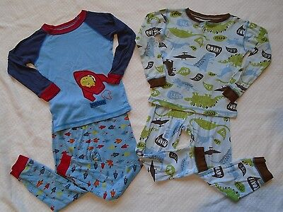 Lot of 2 Carter's Long Sleeve Pajamas Sets Size 4T with Dinosaurs and Rockets