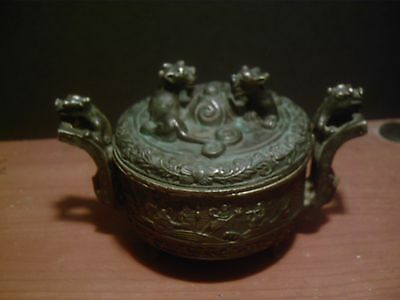 chinese bronze incense burner with chinese lions on the lid and handles
