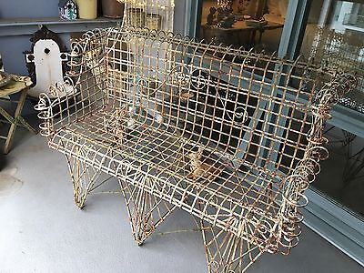 victorian wire bench with a lovely patina. Great condition. 4 feet long.