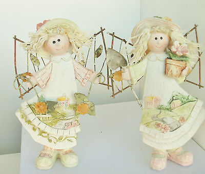 Set of 2 Fairy figurine holding flower garland metal wing carved scene on dress