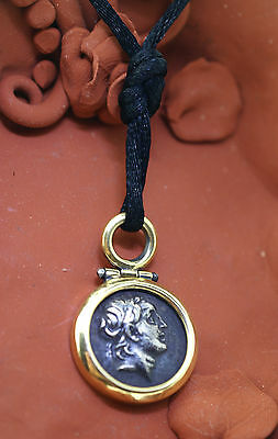 Vintage 14 k yellow gold pendant with silver ancient coin on silk cord, nice