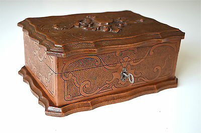 Original antique carved walnut jewelery box with lock and key circa.1900