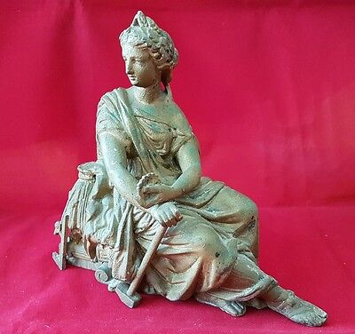 Antique / Vintage metal sculpture of Seated Woman in robes with a big hammer