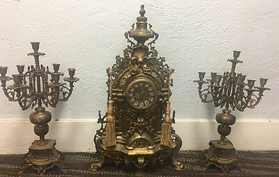Rare French Three Piece Brass Clock Set Assembled 19th c., with a clock