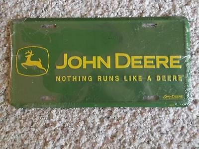 "JOHN DEERE License Plate ""Nothing Runs Like A Deere"" Still Plastic Sealed"