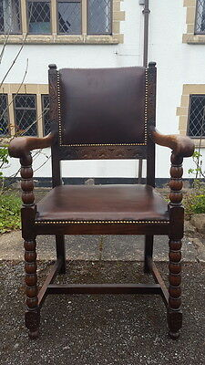 A Stunning Antique Carved Oak Bobbin Gothic Style Studded Leather Carver Chair