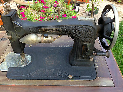 1927 VINTAGE EMBOSSED ROTARY SEWING MACHINE BY WHITE w/ ACCESORIES, MANUAL.