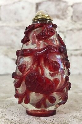 Qing Peking Pearl White Glass Snuff Bottle with Red Floral Pattern and Agate Top
