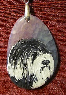 Tibetan Terrier hand painted on an oval pendant/bead/necklace