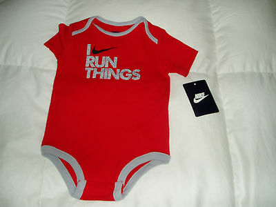 NIKE one-piece snap bodysuit  6/9 months $12.00