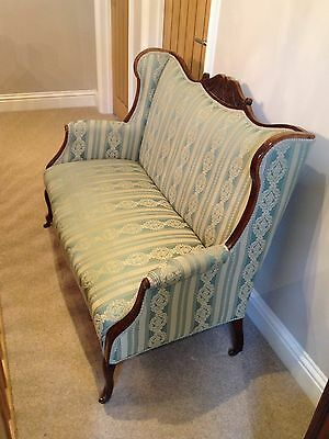 Reupholstered Edwardian Carved Mahogany Two Seat Sofa.
